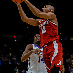 Jan 13, 2018; Baton Rouge, LA, USA; Alabama Crimson Tide guard Dazon Ingram (12) shoots over LSU Tigers guard Randy Onwuasor (14) during the first half at the Pete Maravich Assembly Center. Mandatory Credit: Derick E. Hingle-USA TODAY Sports