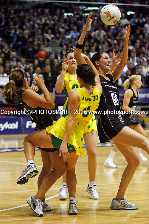 New Zealand's Anna Scarlett disputes the ball with Australia's Natalie von Bertouch in the first netball test at the TSB Arena, Wellington, New Zealand, Thursday, October 12, 2006.    PHOTO :  Anthony Phelps/PHOTOSPORT