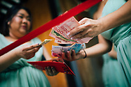 Traditional door games, including the groom bartering his way into the house, at a Chinese wedding, Ko Samui, Thailand, Southeast Asia