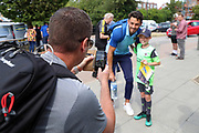 Fan taking photo of AFC Wimbledon defender Will Nightingale (5) during the EFL Sky Bet League 1 match between AFC Wimbledon and Wycombe Wanderers at the Cherry Red Records Stadium, Kingston, England on 31 August 2019.