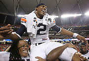 ATLANTA - DECEMBER 4:  Quarterback Cam Newton #2 of the Auburn Tigers is carried on the field after the 2010 SEC Championship against the South Carolina Gamecocks at Georgia Dome on December 4, 2010 in Atlanta, Georgia. (Photo by Mike Zarrilli/Getty Images)