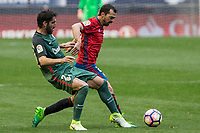 Raul Garcia of Athletic Club competes for the ball with De Las Cuevas of Club Atletico Osasuna during the match of  La Liga between Club Atletico Osasuna and Athletic Club Bilbao at El Sadar Stadium  in Pamplona, Spain. April 01, 2017. (ALTERPHOTOS / Rodrigo Jimenez)