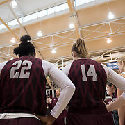 December 16, 2016 - New York, NY : Fordham University Women's Basketball seniors Danielle Burns (22) and Danielle Padovano (14) listen to coach Stephanie Gaitley, center, during an end-of-practice meeting in Rose Hill Gymnasium on Friday afternoon.  CREDIT: Karsten Moran for The New York Times