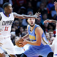 02 October 2015: Denver Nuggets forward Joffrey Lauvergne (77) looks to pass the ball past Los Angeles Clippers forward Josh Smith (5) and Los Angeles Clippers guard Jamal Crawford (11) during the Los Angeles Clippers 103-96 victory over the Denver Nuggets, in a preseason game, at the Staples Center, Los Angeles, California, USA.