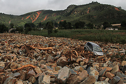 March 23, 2019 - Chimanimani, Zimbabwe - A car sits atop the rocks and debris after being swept away during the cyclone in Ngangu Township Chimanimani. According to the U.N. agency at least 259 people were killed in Zimbabwe by Cyclone Idai, and some 217 are still missing. Hundreds of people had been injured and authorities had confirmed that 16,000 households had been displaced, the International Organization said in a statement. (Credit Image: © Tafadzwa Ufumeli/ZUMA Wire)