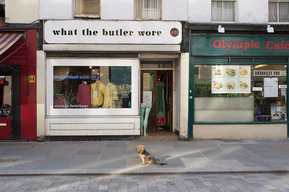 Dog outside shop, Lower Marsh, London.
