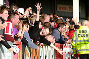 Cheltenham fans cheer after The Robins score their third goal of the day during the Vanarama National League match between Cheltenham Town and Boreham Wood at Whaddon Road, Cheltenham, England on 25 March 2016. Photo by Carl Hewlett.