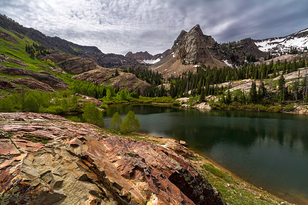Sundial Peak rises above Lake Blanche in Big Cottonwood Canyon. The Wasatch Mountains near Salt Lake City provide grand landscapes only minutes away from a bustling city.