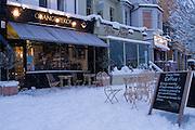 Orange Pekoe Coffee shop during winter snow, Barnes, London.