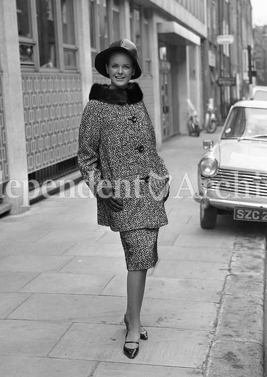 1960s Fashion Model posing on the street, name and location unknown. September 11, 1964. <br />