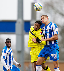 COLCHESTER, ENGLAND - Saturday, February 23, 2013: Tranmere Rovers' Jean-Louis Akpa Akpro in action against Colchester United's captain Josh Thompson during the Football League One match at the Colchester Community Stadium. (Pic by Vegard Grott/Propaganda)