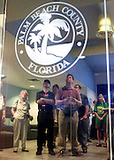 With the seal of Palm Beach County on a door, media and election workers are reflected on glass November 14, 2000 at the Palm Beach County Emergancy Management Center as they watch a live news conference from Tallahassee, Florida where an official announced a state court upheld the 5:00pm November 14 deadline for all votes in the state to be in.  REUTERS/Colin Braley