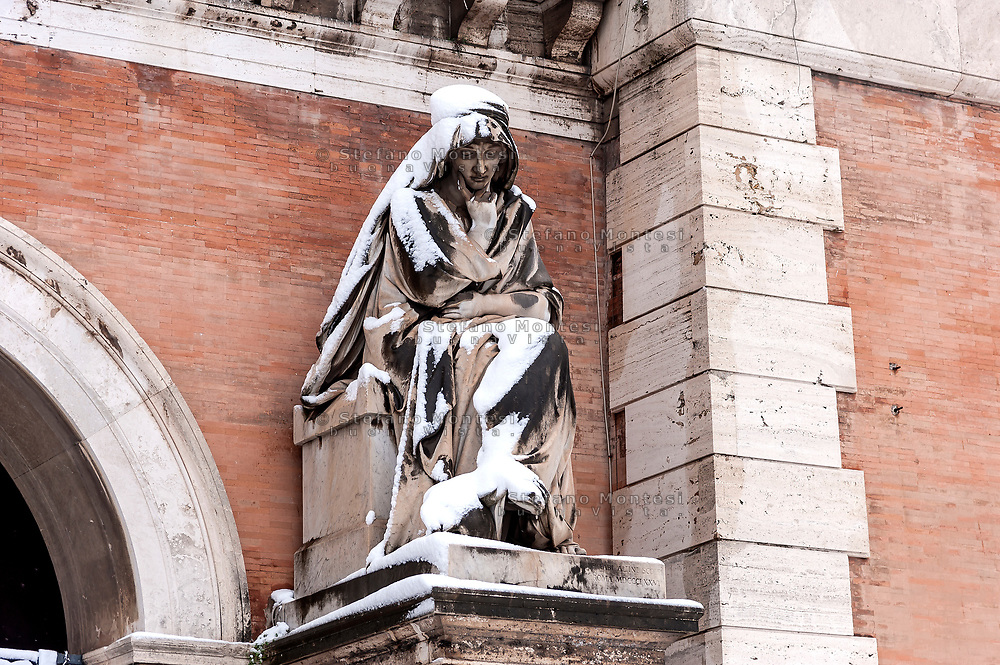 ROME, ITALY - FEBRUARY 26: A statue is covered by snow in front of Verano monumental cemetery in the San Lorenzo district, after the snowfall in the night connected to the arrival of Burian that have whitewashed the capital on February 26, 2018 in Rome, Italy.