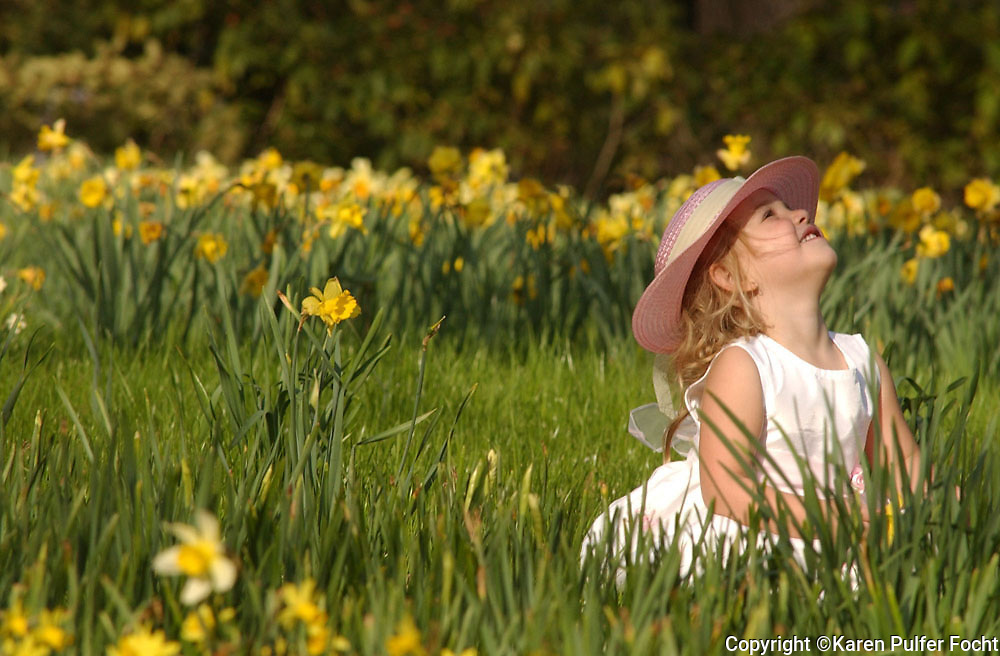 A girl plays in Daffodils.