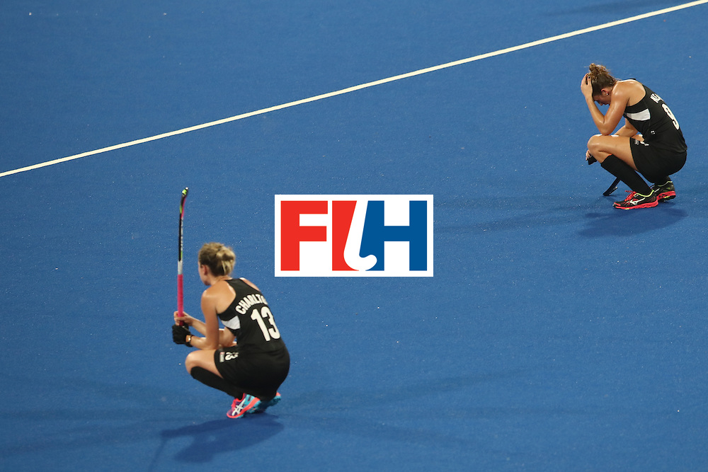 RIO DE JANEIRO, BRAZIL - AUGUST 17:  Samantha Charlton and Brooke Neal of New Zealand  dejected after defeat during the womens semifinal match between the Great Britain and New Zealand on Day 12 of the Rio 2016 Olympic Games at the Olympic Hockey Centre on August 17, 2016 in Rio de Janeiro, Brazil.  (Photo by Mark Kolbe/Getty Images)
