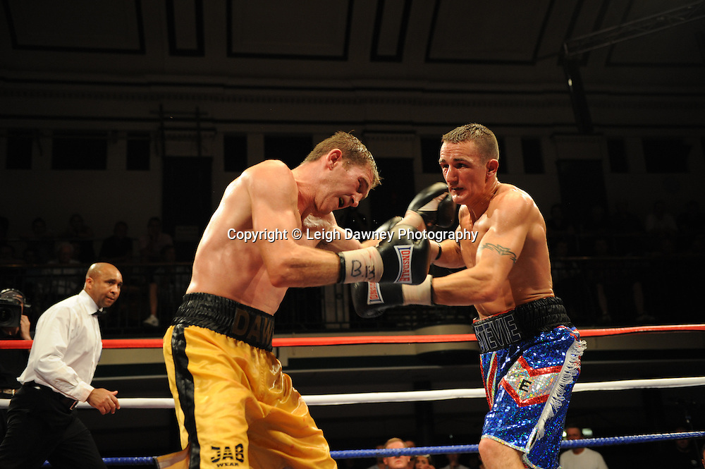 Lenny Daws (yellow shorts) defeats Steve Williams for The British Light Welterweight Title on the 9th July 2010 at York Hall, Bethnal Green, London. Promoter: Matchroom Sport. Photo credit: © Leigh Dawney