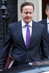 © licensed to London News Pictures. London, UK 08/01/2014. Prime Minister David Cameron leaving Downing Street on Wednesday, 08 January 2014. Photo credit: Tolga Akmen/LNP