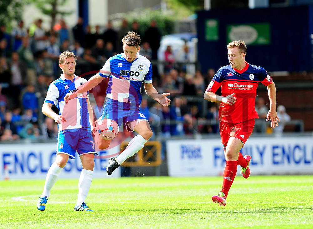 Bristol Rovers' Ollie Clarke is challenged by AFC Telford's Adam Farrell - Photo mandatory by-line: Neil Brookman - Mobile: 07966 386802 23/08/2014 - SPORT - FOOTBALL - Bristol - Memorial Stadium - Bristol Rovers v AFC Telford - Vanarama Football Conference