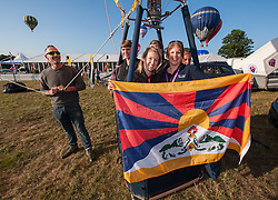 """© Licensed to London News Pictures. 08/08/2015. Bristol, UK. Day 3 of the Bristol International Balloon Fiesta 2015.  """"Team Tashi"""" (Tashi means good fortune) in the Tibet balloon which is probably the largest Tibetan flag in the world.  The balloon has attracted some controversy as Chinese embassy officials have made several attempts to have the balloon grounded, by asking balloon festival organisers in Spain, France and the UK to cancel the balloon's entry to festivals.  The Bristol International Balloon Fiesta have refused to ban the Tibet balloon.  Photo credit : Simon Chapman/LNP"""