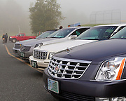 BARTON VT - 144th Orleans County Fair in the scenic Northeast Kingdom village of Barton, Vermont broke the Guinness World Records of the longest Cadillac Parade in history with 298 cars Wednesday in Barton Vermont. Early arrivals begin to line up in the fog at Lake Region High Scool parking lot..
