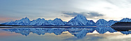 """Ice out sunrise. Jackson Lake Panorama right after the ice melted.<br /> <br /> For production prints or stock photos click the Purchase Print/License Photo Button in upper Right; for Fine Art """"Custom Prints"""" contact Daryl - 208-709-3250 or dh@greater-yellowstone.com"""