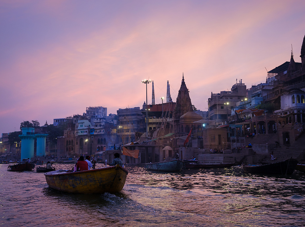 Varanasi, INDIA - CIRCA NOVEMBER 2018: Ganges river at dusk in Varanasi. Varanasi is the spiritual capital of India, the holiest of the seven sacred cities and with that one the most frequented places for Sadhus.