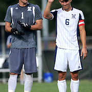 UNCW's Jacob VanCompernolle, right, waves to the crowd before a match against Winthrop. (Jason A. Frizzelle)