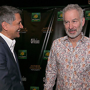 March 6, 2015, Indian Wells, California:<br /> John McEnroe speaks with Joe Kiani, Founder, Charirman, and CEO of Masimo during the McEnroe Challenge for Charity VIP Draw Ceremony in Stadium 2 at the Indian Wells Tennis Garden in Indian Wells, California Friday, March 6, 2015.<br /> (Photo by Billie Weiss/BNP Paribas Open)