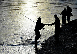 Anglers from all over the country arrived in Kinclaven, Perthshire for the first day of the new salmon fishing season on the River Tay, which is marked with whisky and sees the anglers led to the water by pipers.<br /> <br /> &copy; Dave Johnston / EEm