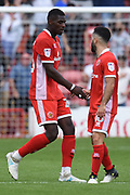 Goalscorer Walsall striker Amadou Bakayoko (20) celebrates with Walsall midfielder Erhun Oztumer (10) 3-3 during the EFL Sky Bet League 1 match between Walsall and Bradford City at the Banks's Stadium, Walsall, England on 26 August 2017. Photo by Alan Franklin.