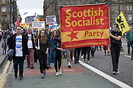 Scottish Socialist party members with a banner marching down North Bridge in Edinburgh during a pro-Independence march and rally in the Scottish capital. The event, which was staged in support of the pro-Independence movement, was attended by an estimated by approximately 30,000 people. The referendum to decide whether Scotland will become an independent nation will be staged on 18th September 2014.