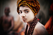 A boy who was initiated as a Naga at a very young age. Mostly, these young boys who end up being a Naga are orphans or kids who ran away from home.<br /> <br /> Kumbh Mela, 2010, Haridwar, Uttarakhand.