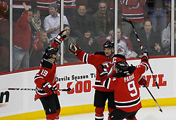 Feb 26, 2009; Newark, NJ, USA; New Jersey Devils center Travis Zajac (19), New Jersey Devils right wing Jamie Langenbrunner (15) and New Jersey Devils left wing Zach Parise (9) celebrate Langenbrunner's goal during the first period at the Prudential Center.
