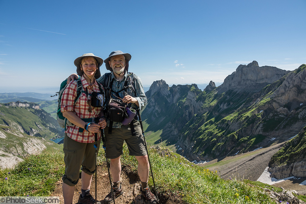 Hikers at Rotsteinpass (2120 m) in the Alpstein limestone mountain range, Appenzell Alps, Switzerland, Europe. Appenzell Innerrhoden is Switzerland's most traditional and smallest-population canton (second smallest by area). For licensing options, please inquire.
