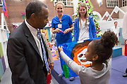 Retired Neurosurgeon and Republican presidential candidate Dr. Ben Carson reacts to a young patients artwork during a visit to the MUSC Children's Hospital December 22, 2015 in Charleston, South Carolina. Carson stopped by to listen to Christmas carols and greet the young patients.