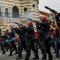 Malaysian riot police fire a teargas to protestor during a crackdown on Bersih rally calling for electoral reforms  in Kuala Lumpur, Malaysia 9 July 2011. With national elections due by 2013, the opposition backed protest, Bersih is demanding reforms including measures to prevent vote-buying and fraud.