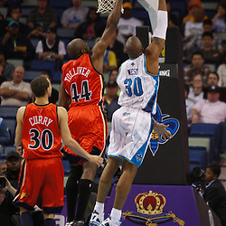 Mar 08, 2010; New Orleans, LA, USA; New Orleans Hornets forward David West (30) shoots over Golden State Warriors center Anthony Tolliver (44) during the first half at the New Orleans Arena. Mandatory Credit: Derick E. Hingle-US PRESSWIRE