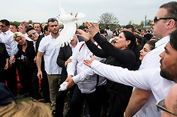 © Licensed to London News Pictures. 21/04/2018. London, UK. Mourners release doves at the burial of traveller 'Queenie, Elizabeth Doherty at Kensal Green Cemetery in west London, following a funeral service in Cobham, Surrey. Elizabeth Doherty, whose son Paddy Doherty is known for appearing on My Big Fat Gypsy Wedding and winning Celebrity Big Brother 8, died of a heart attack earlier this month. Paddy Doherty claimed his mother has died of a 'broken heart' following the death of her husband almost a year ago. Photo credit: Ben Cawthra/LNP