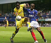 Photo: Lee Earle.<br /> Portsmouth v Leeds United. Carling Cup. 28/08/2007.Leeds Tomi Ameobi (L) battles with Sylvain Distin.