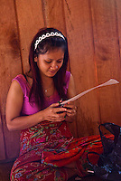 Young woman doing the preparations to make a new woven mat.