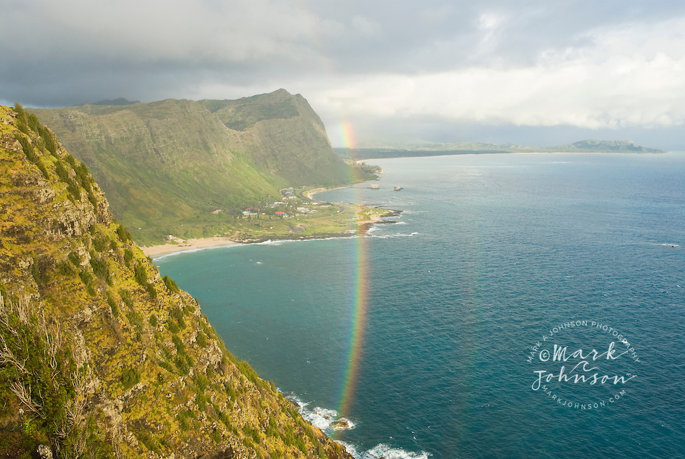 "Rainbow seen from Makapu'u Point, ""Sea Life Park"" and Oceanic Institute's Pier in background, SE coast of Oahu, Hawaii"