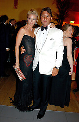 MISS TAMARA BECKWITH and MR GEORGE VERONI  at Andy & Patti Wong's Chinese New Year party to celebrate the year of the Rooster held at the Great Eastern Hotel, Liverpool Street, London on 29th January 2005.  Guests were invited to dress in 1920's Shanghai fashion.<br />