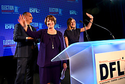 Sen. Amy Klobuchar stands beside her husband, John Bessler, and her daughter, Abigail, at the conclusion of her acceptance speech at the Intercontinental Hotel in St. Paul, Minn., at DFL headquarters election party on Tuesday, November 6, 2018. Photo by Aaron Lavinsky/Minneapolis Star Tribune/TNS/ABACAPRESS.COM