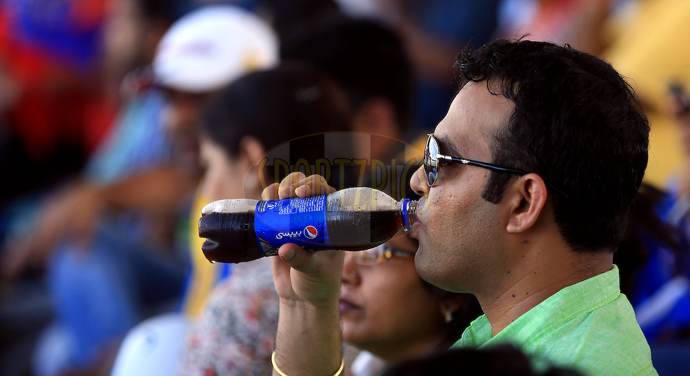 Fan's enjoys Pepsi drink during match 16 of the Pepsi Indian Premier League 2014 between the Delhi Daredevils and the Mumbai Indians held at the Sharjah Cricket Stadium, Sharjah, United Arab Emirates on the 27th April 2014<br /> <br /> Photo by Sandeep Shetty / IPL / SPORTZPICS