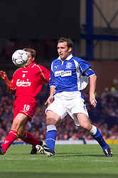 LIVERPOOL, ENGLAND - Saturday, September 15, 2001: Liverpool's Michael Owen and Everton's Alan Stubbs during the Premiership match at Goodison Park. (Pic by David Rawcliffe/Propaganda)