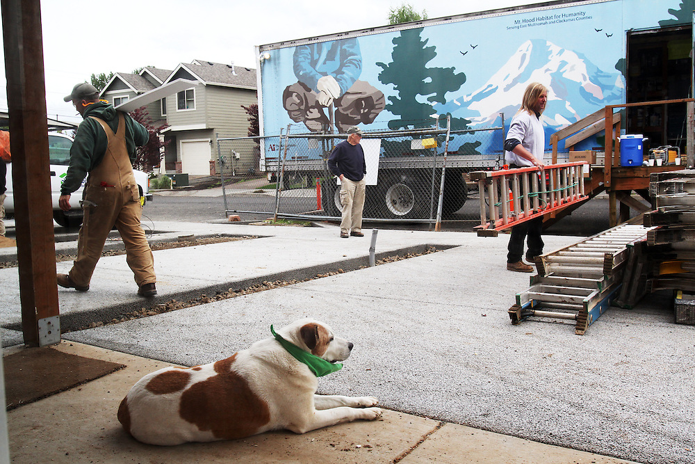 Porter the dog watches the construction unfold...John Gray was born 92 years ago and grew up poor in rural Oregon. He made a fortune in the chainsaw industry after World War II, and now he has donated more than a million dollars to Habitat for Humanity to buy land in Portland for low-income housing. Volunteers work to build solid foundations on the largest of these land parcels on Wednesday, May 2, 2012.