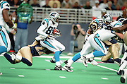 Wide Receiver Steve Smith (89) of the Carolina Panthers gets tackled by Defensive back Jacoby Shepherd (22) of the St. Louis Rams during a 48 to 14 win by the Rams on 11/11/2001..©Wesley Hitt/NFL Photos