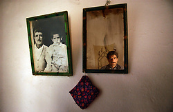 Ali Ipak looks on in the mirror next to a photograph of himself as a child with his father December 12, 2005 in central Turkey, Konya in Kutoren district, about 400 kilometers from Ankara.  (Ami Vitale)