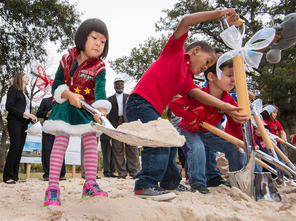 Students participate in a groundbreaking ceremony for the new Mandarin Chinese Language Immersion Magnet School, December 6, 2014.