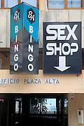 Shop signs advertising Bingo and a Sex shop in city centre of Algeciras, Spain